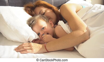 mom with son baby woke up in the morning on the bed 1