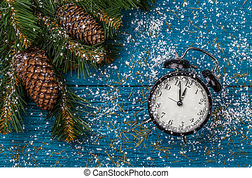 Image of Christmas branches of spruce, cones and clocks,...