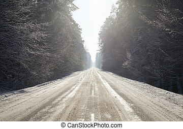 snow-covered road in the winter season. landscape photo