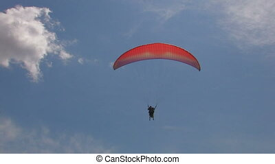 paragliding in blue sky