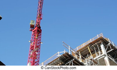 Red crane at work Timelapse - Red tower crane at...