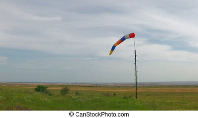 windsock moving from wind in green field, Canon XH A1, Full...