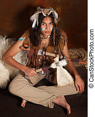 Sitting Indian - Portrait of an Indian in traditional...