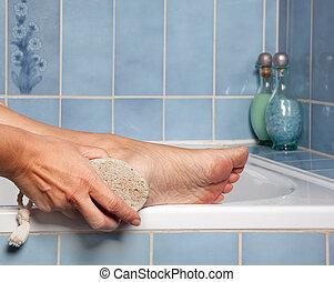 Pumice stone removing callus - Hand removing callus from...