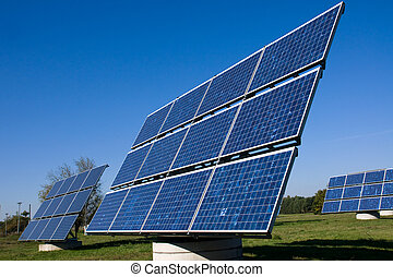 Various solar energy panels on green grass