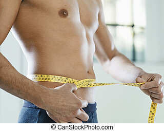 male beauty - cropped view of caucasian young man measuring...