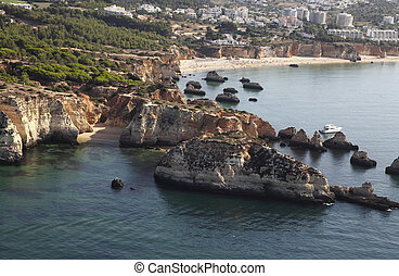Aerial view of the cliffs and beach in Alvor (Algarve,...