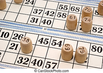 Lotto - Kegs with numbers on the Lotto cards closeup
