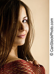 Beauty woman with long hairs look at you