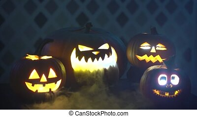 Scary funny angry big orange halloween pumpkins in fire,...