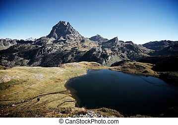 Pyrenees - Midi Dossau Peak reflected and Gentau lake. Ossau...