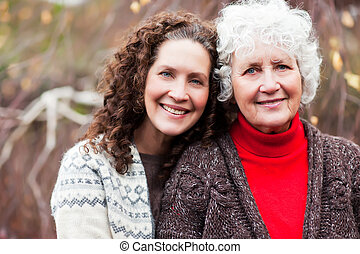 Grandmother with her daughter - A portrait of a happy senior...