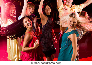 Moving - Portrait of energetic people clubbing at...