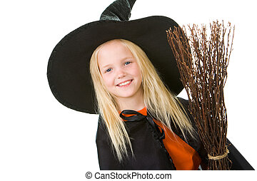 Happy girl - Portrait of girl in witch costume looking at...
