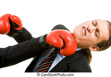 Attack - Portrait of defeated businessman in boxing gloves...
