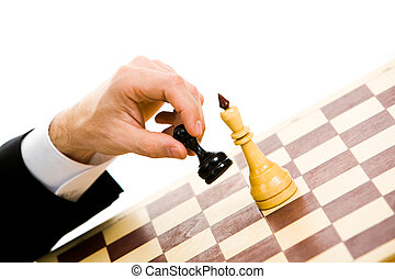 Make the move - A chess player making his next chess move