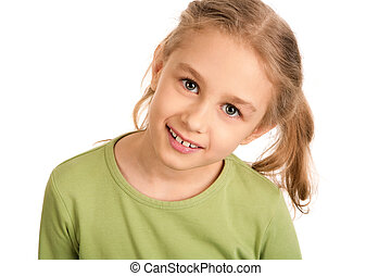 Cutie - Portrait of smiling girl looking at camera over...