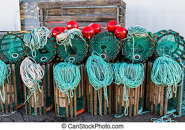 Lobster traps standing on a pier prepared for fishing with...