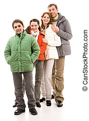 Fashionable family - Happy family members in warm jackets...