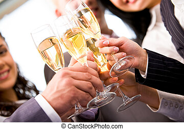 Cheers - Close-up of friends hands holding glasses with...