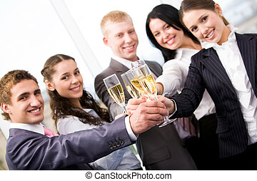 Happy New Year - Image of friends making cheers and looking...