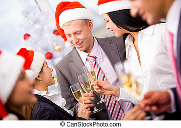 Christmas party - Image of cheering friends in Santa caps...