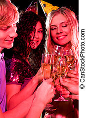 Birthday - Vertical image of three friends clinking glasses...