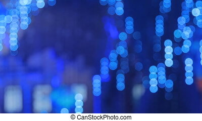 Abstract defocused blue lighting bokeh at futuristic modern...