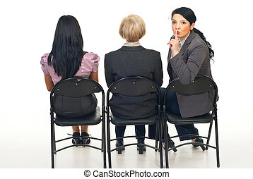 Hush!Be quiet! - Three business women sitting on chairs...