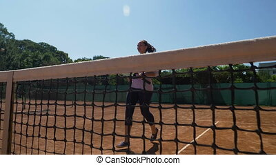 Woman tennis player comes running to the fillet and makes...
