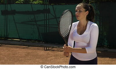 Slow motion with tired woman tennis player girl hitting ball...