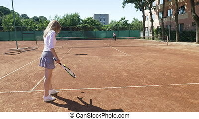 Woman takes tennis classes with coach