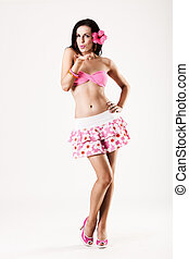 Attractive girl wearing pink skirt blowing a kiss -...