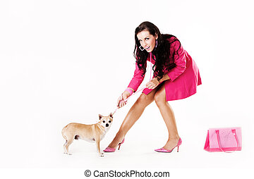 Young sexy woman dressed in pink pulling dog - Young sexy...