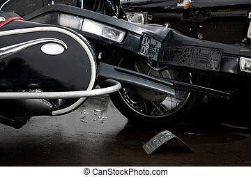 Car crash - An accident between a motorcycle and a car