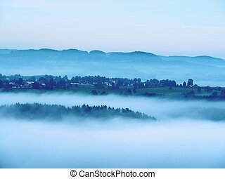 Cold misty blue morning. A minute before sunrise in a...