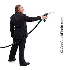 Business man pointing with gas nozzle - Side view of a...