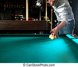 Pool Piquet - Pool player during a massee shot in a dimly...