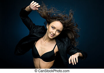 dancing woman with flyaway hair - Portrait of the beautiful...