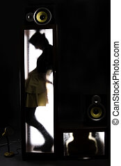 A girl behind the glass door as a concept of loneliness and...