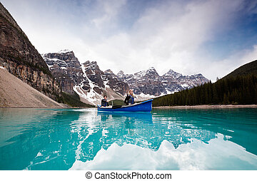 Scenic shot of couple sailing on calm water - Man and woman...