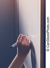Hand writing on whiteboard - office, business and education...