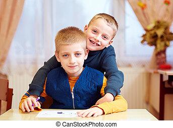 two cute kids, friends in rehabilitation school for kids...