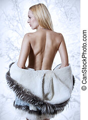 Sexy blonde woman in fur coat back - Sexy blonde woman in...