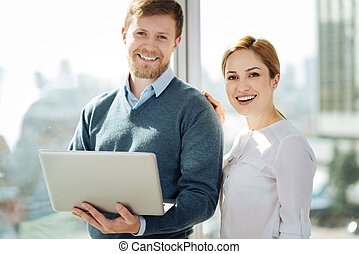 Positive delighted office workers posing on camera - Step by...