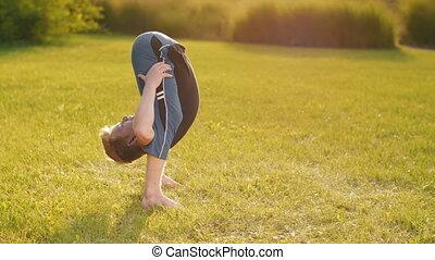 Flexible Man do Yoga - Young man with flexible body do yoga.