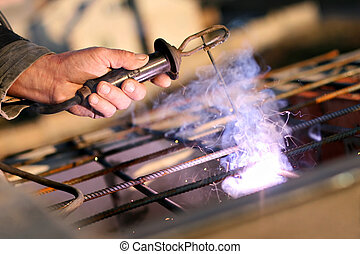 Welding - welder holds the welding arm Appliances