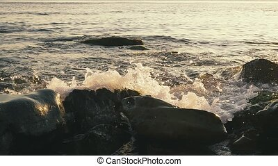 Slow mo large stones in the foreground in water - Slow mo...