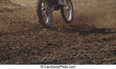 Dirt From Under the Motorcycle - Motocross bikers skidding...
