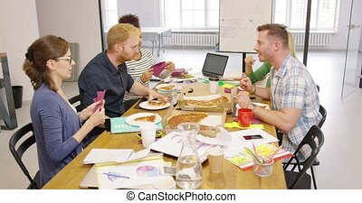 Colleagues enjoying pizza - Group of colleagues in casual...